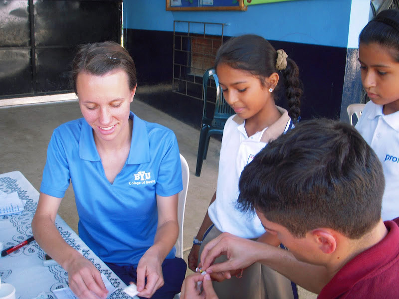 Student Nurse with children in Ecuador