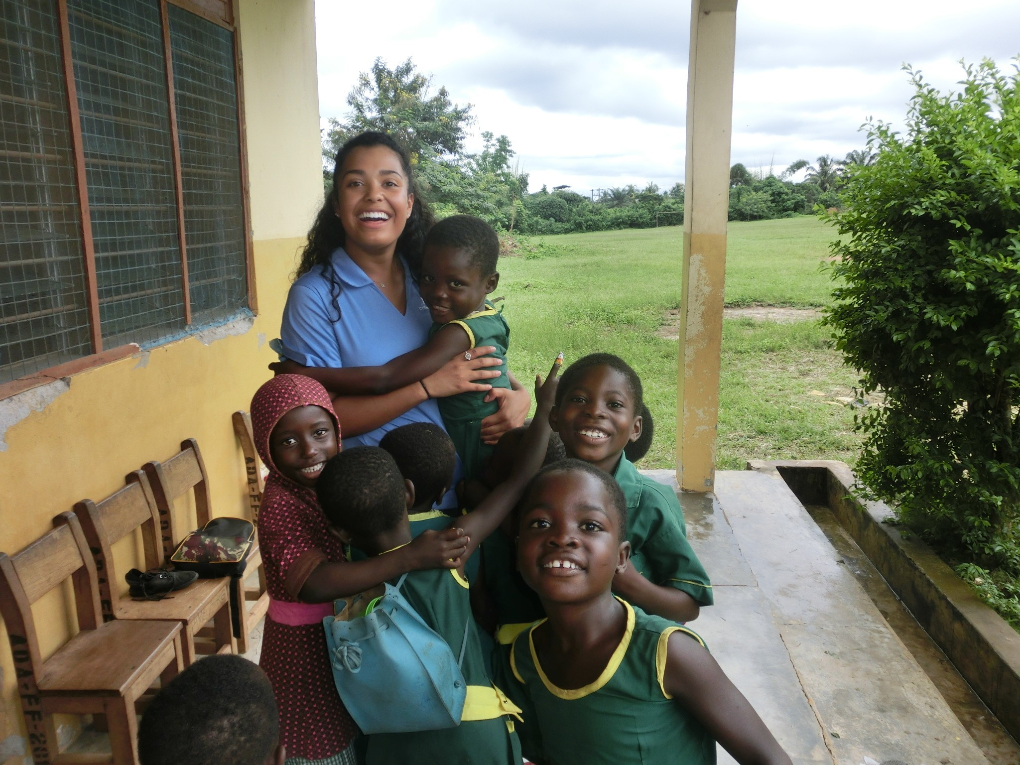 Student Nurse with children in Ghana