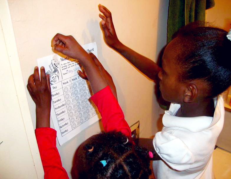 Children posting dental tracking chart