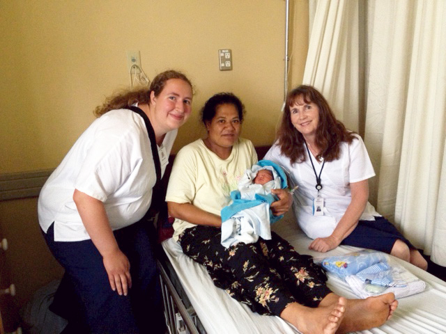 Nurses with mother and child in Tonga