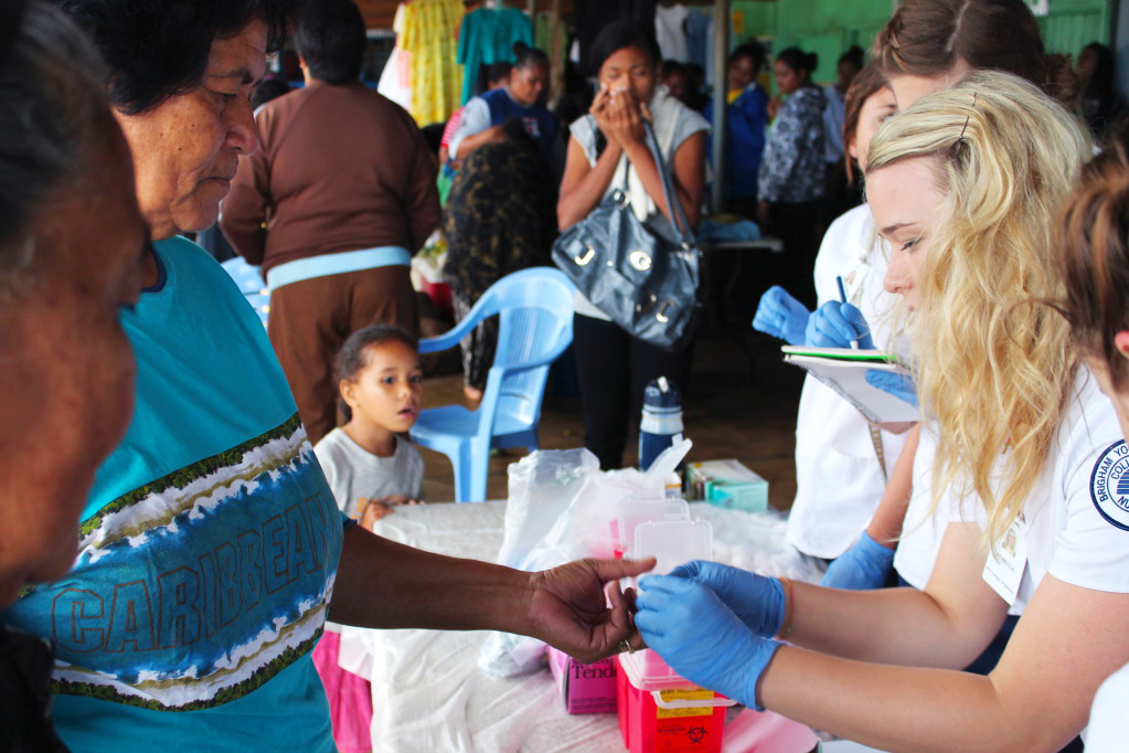 Student nurse with children in Tonga